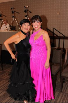 Two ladies in ballroom dance gowns